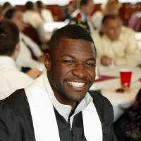 Photo - OU: University of Oklahoma college football standout Mark Clayton attends a graduation reception on Friday, May 14, 2010, in Norman, Okla.  Photo by Steve Sisney, The Oklahoman ORG XMIT: KOD