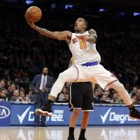 Photo - New York Knicks guard J.R. Smith (8) shoots a layup against the Brooklyn Nets in the first half of their NBA basketball game at Madison Square Garden in New York, Monday, Jan. 21, 2013. (AP Photo/Kathy Willens)
