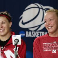 Photo - Nebraska's Jordan Hooper, left, and Emily Cady smile during a news conference on Sunday, March 23, 2014, in Los Angeles. Nebraska is scheduled to play BYU in a second-round game of the NCAA women's college basketball tournament on Monday. (AP Photo/Jae C. Hong)
