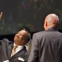 Photo - Rev. Fred Luter Jr. points upward after being re-elected as the Southern Baptist Convention's president during the 2013 Southern Baptist Convention Annual Meeting at the George R. Brown Convention Center Tuesday, June 11, 2013, in Houston. Luter was the SBC's first black president. (AP Photo/Houston Chronicle, Johnny Hanson)