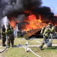 Photo - Firefighters battle a fire at the home of Robert Silvy, 84, whose house exploded on Wednesday. Silvy died on Thursday. Photo by Rolf Clements / The Ponca City News  ORG XMIT: KOD  Roff Clements - Rolf Clements / The Ponca City N