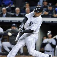 Photo -   New York Yankees' Raul Ibanez hits a home run during the ninth inning of Game 3 of the Yankees' American League division baseball series against the Baltimore Orioles on Wednesday, Oct. 10, 2012, in New York. (AP Photo/Bill Kostroun)