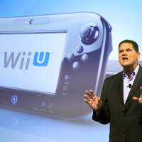 Photo -   FILE - In this Sept. 13, 2012 photo, Reggie Fils-Aime, president and chief operating officer of Nintendo of America, discusses the upcoming Wii U gaming console, in New York. Much like the iPad, the curvey GamePad features a touchscreen that can be manipulated with the simple tap or swipe of a finger, but it's surrounded by the kinds of buttons, bumpers, thumbsticks and triggers that are traditionally found on a modern-day game controller. The gaming console will start at $300 and go on sale in the U.S. on Sunday, Nov. 18, in time for the holidays, the company said. (AP Photo/Mark Lennihan, File)