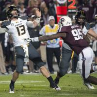 Photo -   Missouri quarterback Corbin Berkstresser (13) passes under pressure by Texas A&M's Julien Obioha (95) during the second quarter of an NCAA college football game on Saturday, Nov. 24, 2012, in College Station, Texas. (AP Photo/Dave Einsel)