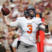 Photo - OSU quarterback Brandon Weeden (3) passes in the first half of the Cowboys game vs. Texas A&M on Saturday. Photo by Nate Billings, The Oklahoman