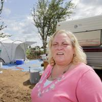 Photo - Bethel Acres tornado victim Kristina Miller says she is third in line to get a new frame home through efforts coordinated by God's Hand Ups-IGLM.  Photo by David McDaniel, The Oklahoman  David McDaniel - The Oklahoman