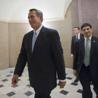 Photo - FILE - This Jan. 15, 2013 file photo shows House Speaker John Boehner of Ohio walking on Capitol Hill in Washington. Republican leaders scramble for votes on a stopgap debt-limit measure that would let the government keep borrowing until at least mid-May, giving up for now on trying to win spending cuts from Democrats in return. But the respite would be only temporary, with major battles still to come between the GOP and President Barack Obama over taxes, spending and deficits. (AP Photo/J. Scott Applewhite, File)