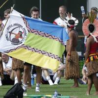 Photo - German's national soccer player Miroslav Klose dances with Brazilian indigenous after a training near Porto Seguro, Brazil, Monday, June 9, 2014. Germany will play in group G of the 2014 soccer World Cup. (AP Photo/Matthias Schrader)