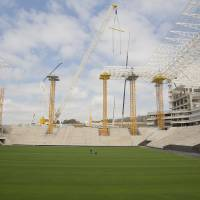 Photo - A view of the Arena Corinthians construction site, in Sao Paulo, Brazil, Monday, Aug. 19, 2013. The new stadium will host the opening match of the World Cup in 2014. (AP Photo/Andre Penner)