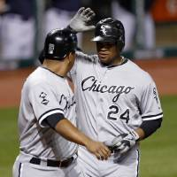 Photo -   Chicago White Sox's Dayan Viciedo, right, is congratulated by Jose Lopez after Viciedo hit a two-run home run off Cleveland Indians relief pitcher Chris Perez in the ninth inning of a baseball game, Tuesday, Oct. 2, 2012, in Cleveland. Lopez scored on the homer. (AP Photo/Tony Dejak)