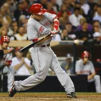 Photo - Cincinnati Reds' Todd Frazier connects for a base hit that drives in Zack Cozart for a Reds' run in the fifth inning of a baseball game against the San Diego Padres, Tuesday, July 1, 2014, in San Diego. (AP Photo/Lenny Ignelzi)