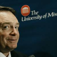 Photo - New University of Mississippi college football coach Houston Nutt speaks to reporters following his official introduction before fans, students, players, faculty and staff on campus,  Wednesday, Nov. 28, 2007, in Oxford, Miss. (AP Photo/Rogelio V. Solis) ORG XMIT: MSRS105