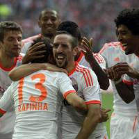 Photo -   Munich teammates celebrate after scoring during the German first division Bundesliga soccer match between Fortuna Duesseldorf and Bayern Munich in Duesseldorf, Germany, Saturday, Oct. 20, 2012. Munich won by 5-0. (AP Photo/Frank Augstein)