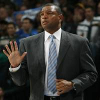 Photo - Boston head coach Doc Rivers signals his team in the first half during the NBA basketball game between the Oklahoma City Thunder and the Boston Celtics at the Ford Center in Oklahoma City, Wednesday, Nov. 5, 2008. BY NATE BILLINGS, THE OKLAHOMAN ORG XMIT: KOD