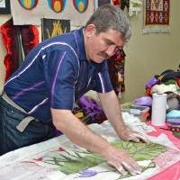 Photo -  Felt artist Oguz Koc, of Ankara, Turkey, demonstrates the art of felting. He traveled to Oklahoma City for the festival at the Raindrop Turkish House. Photo by M. Tim Blake, for The Oklahoman   M. Tim Blake