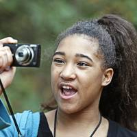 Photo - Katyra, 10, takes photos during an outing with The Boys and Girls Club's new program called