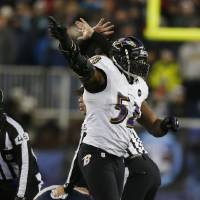 Photo - Baltimore Ravens inside linebacker Ray Lewis (52) reacts after the Ravens recovered a fumble during the second half of the NFL football AFC Championship football game against the New England Patriots in Foxborough, Mass., Sunday, Jan. 20, 2013. (AP Photo/Charles Krupa)