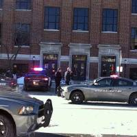 Photo - Police investigate reports of a shooting at Purdue University in West Lafayette, Ind., on Tuesday, Jan. 21, 2014. Police say they have a person in custody and the university says it told people to take shelter and have cleared the building as the area is searched. (AP Photo/The Journal & Courier, John Terhune)