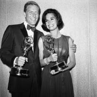 Photo - FILE - Dick Van Dyke, left, and Mary Tyler Moore co-stars of The Dick Van Dyke Show pose backstage at the Palladium with the Emmys won in the Television Academy's 16th annual awards show, in Los Angeles, Calif. They won the Emmy Award for best actor and actress in a series. Van Dyke is the recipient of the Life Achievement Award at the upcoming 19th Annual SAG Awards ceremony on Sunday, Jan. 27, 2013. (AP Photo, File)