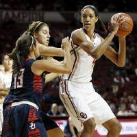 Photo - Oklahoma's Nicole Griffin (4) looks to pass away from Samford's Christy Robinson (34) and Brittany Stevens (13) during a women's college basketball game between the University of Oklahoma Sooners (OU) and the Samford Bulldogs at Lloyd Noble Center in Norman, Okla., Sunday, Dec. 29, 2013. Photo by Nate Billings, The Oklahoman