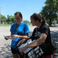 Photo - Chelsea Boyd, 21, and Abbey Stroder, 19, Quail Springs Baptist Church children's ministry interns, check a map to find an apartment to deliver a free lunch at the Terrace Apartments in west Oklahoma City.  Carla Hinton - The Oklahoman