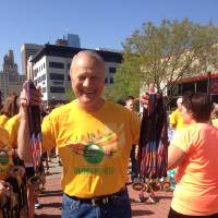 Photo - Former Oklahoma football coach Barry Switzer handed out medals at the finish line of the Oklahoma City Memorial Marathon on Sunday, April 28, 2013. PHOTO BY STEPHANIE KUZYDYM, THE OKLAHOMAN
