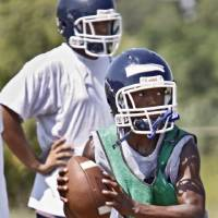 Photo - Star Spencer quarterback Darion Bogus rolls out for a pass during football practice at Star Spencer High School on Thursday, Aug 12, 2010, in Oklahoma City, Okla.   Photo by Chris Landsberger, The Oklahoman