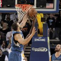 Photo -   Minnesota Timberwolves' Nikola Pekovic, of Montenegro, blocks the shot of Golden State Warriors' Festus Ezeli (31) in the first quarter of an NBA basketball game in Oakland, Calif., Saturday, Nov. 24, 2012. Watching at right is Timberwolves' Kevin Love (42). (AP Photo/Mathew Sumner)