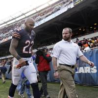 Photo - Chicago Bears running back Matt Forte (22) walks to the locker room with a trainer after getting injured in the second half of an NFL football game against the Minnesota Vikings in Chicago, Sunday, Nov. 25, 2012. (AP Photo/Nam Y. Huh)