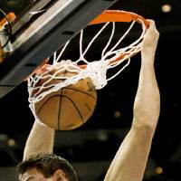 Photo - Denver Nuggets' Danilo Gallinari slams one down during the first quarter of an NBA basketball game against the Cleveland Cavaliers Friday, Jan. 11, 2013, in Denver. (AP Photo/Barry Gutierrez)