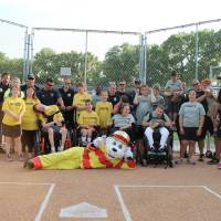 Photo -  Sparky, the Yukon Fire Department's mascot, poses with participants in the Yukon Spirit Baseball League for special needs children in Yukon. The league is sponsored by the Yukon police and fire departments and the parks and recreation department. PHOTO PROVIDED   PROVIDED