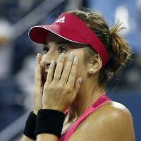 Photo - Belinda Bencic, of Switzerland, reacts after her upset victory over Jelena Jankovic, of Serbia, in the fourth round of the 2014 U.S. Open tennis tournament, Sunday, Aug. 31, 2014, in New York. Bencic won 7-6 (6), 6-3.(AP Photo/Elise Amendola)