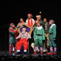 Photo - Above: OK Chorale members perform a sketch with Santa during the group's Christmas show Saturday at Putnam City West High School.