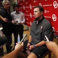 Photo - COLLEGE FOOTBALL / MUG: Head coach Bob Stoops speaks to the press at a media availability for the University of Oklahoma Sooner (OU) football team following practice on Tuesday, Aug. 21, 2012 in Norman, Okla.  Photo by Steve Sisney, The Oklahoman