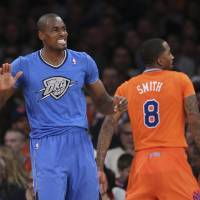 Photo -  The sleeved jerseys had a more negative effect on the viewing public than the Thunder on Christmas Day. (AP Photo/John Minchillo)