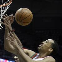 Photo -   Toronto Raptors' Alan Anderson, left, and Milwaukee Bucks' Shaun Livingston (9) battle for a loose ball during the first half of an NBA basketball game Monday, April 23, 2012, in Milwaukee. (AP Photo/Morry Gash)