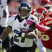 Photo -   Baltimore Ravens running back Ray Rice (27) is tackled by Kansas City Chiefs cornerback Stanford Routt (26) during the first half of an NFL football game at Arrowhead Stadium in Kansas City, Mo., Sunday, Oct. 7, 2012. (AP Photo/Colin E. Braley)