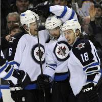 Photo - Winnipeg Jets' defenseman Ron Hainsey (6), left winger Andrew Ladd (16) and center Brian Little (18) celebrate a goal by Ladd during the second period of an NHL hockey game against the Buffalo Sabres in Buffalo, N.Y., Tuesday, Feb. 19, 2013. (AP Photo/Gary Wiepert)