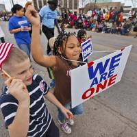 Photo - Micheal Mills, 7, and Ayanna Morales, 7, march in the streets during Martin Luther King Jr. Day parade through downtown Oklahoma City on Monday, Jan. 16, 2012, in Oklahoma City, Okla. Photo by Chris Landsberger, The Oklahoman