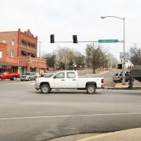 Photo - Right: Vehicles travel through the downtown Wynnewood intersection of Robert S. Kerr Blvd. and Dean A. McGee Ave.  PHOTOS BY STEVE SISNEY,  THE OKLAHOMAN