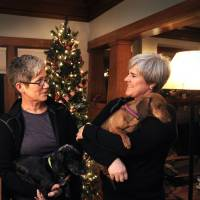 Photo - Former Army Major Margaret Witt, right, and Lori Johnson, left, stand in their south hill home, Monday, Dec. 3, 2012 in Spokane, Wash. They are planning to marry in a few weeks after receiving one of the first marriage licenses for same sex couples this week. Witt fought the Army over