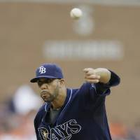 Photo - Tampa Bay Rays starting pitcher David Price throws during the second inning of a baseball game against the Detroit Tigers in Detroit, Sunday, July 6, 2014. (AP Photo/Carlos Osorio)