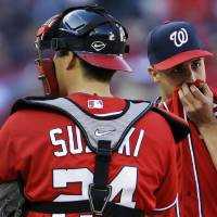 Photo -   Washington Nationals starting pitcher Gio Gonzalez, right, stands on the mound with catcher Kurt Suzuki after walking St. Louis Cardinals' Carlos Beltran during the fifth inning in Game 1 of baseball's National League division series, Sunday, Oct. 7, 2012, in St. Louis. (AP Photo/Jeff Roberson)