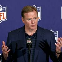 Photo - FILE - In this March 20, 2013 file photo, NFL Commissioner Roger Goodell answers a reporter's question during a news conference during the annual NFL football meetings in Phoenix. The NFL has ordered all teams to have cameras in their locker rooms next season, with video shown only on stadium scoreboards. It's part of Goodell's initiative for