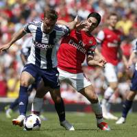 Photo - Arsenal's Mikel Arteta, right, competes for the ball with West Bromwich Albion's James Morrison during their English Premier League soccer match at Emirates Stadium in London, Sunday, May 4, 2014. (AP Photo/Sang Tan)