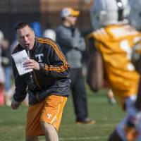 Photo - FILE - In this March 8, 2014 file photo, Tennessee head coach Butch Jones yells to his squad during spring practice in Knoxville, Tenn. Tennessee's Orange & White Game on Saturday, April 12, 2014, won't end the Volunteers' quarterback competition, but it should put the four-way battle into clearer focus.  (AP Photo/The Knoxville News Sentinel, Paul Efird, File)
