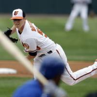 Photo - Baltimore Orioles starting pitcher Zach Britton throws during the first inning of an exhibition spring training baseball game against the Toronto Blue Jays, Wednesday, March 20, 2013 in Sarasota, Fla. (AP Photo/Carlos Osorio)