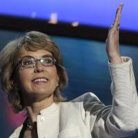 Photo - FILE - In this Sept. 6, 2012 file photo, former Arizona Rep. Gabrielle Giffords blows a kiss after reciting the Pledge of Allegiance at the Democratic National Convention in Charlotte, N.C. A spokesman on Thursday, Jan. 3, 2013 said Connecticut's lieutenant governor has been invited to attend a meeting between Giffords and families of the victims of the deadly Newtown elementary school shooting. (AP Photo/Charles Dharapak, File)