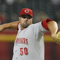 Photo - FILE - This Aug. 27, 2012 file photo shows Cincinnati Reds' Jonathan Broxton throwing against the Arizona Diamondbacks during a baseball game in Phoenix. The Reds have signed Broxton to a three-year, $21 million contract, giving the NL Central champions a potential closer. (AP Photo/Ross D. Franklin, File)