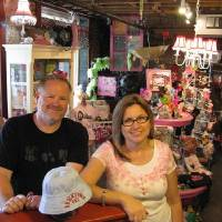 Photo - Chad Huntington, co-owner of the Bricktown Marketplace, and Paula Piccin, owner of the Name Droppers retail booth.  STEVE LACKMEYER - BUSINESS WRITER